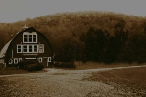 Barn-Wedding-Venue-Exterior-View-Mountains-Background-Dark-Overlay