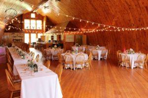 Barn-Wedding-Venue-Interior-Daytime-Photo-Tablecloths