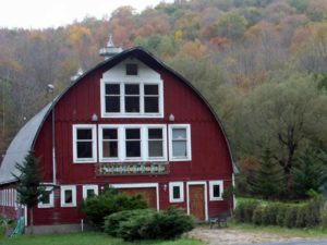 Red-Barn-Venue-fall-trees-in-background