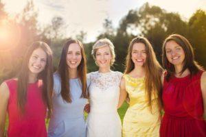 bride-with-bridesmaids-outside-rustic-barn-wedding-venue