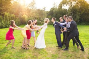 bridesmaids-vs-groomsmen-outside-rustic-barn-wedding-venue