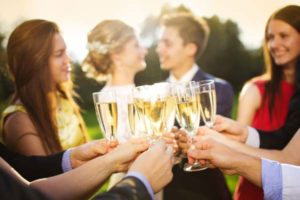champagne-toast-outside-rustic-barn-wedding-venue