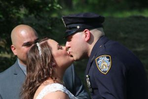 couple-first-kiss-outdoor-barn-wedding