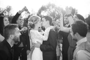 first-kiss-newlyweds-rustic-barn-wedding-venue-Greyscale