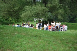outside-wedding-ceremony-at-the-barn-venue