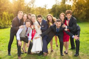 wedding-party-acting-silly-outside-rustic-barn-wedding-venue