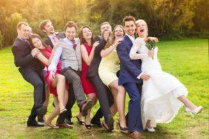 wedding-party-conga-line-outside-rustic-barn-wedding-venue