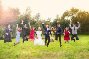 wedding-party-jumping-outside-rustic-barn-wedding-venue