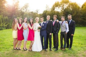 wedding-party-serious-pose-outside-rustic-barn-wedding-venue