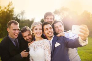 wedding-party-taking-selfie-outside-rustic-barn-wedding-venue